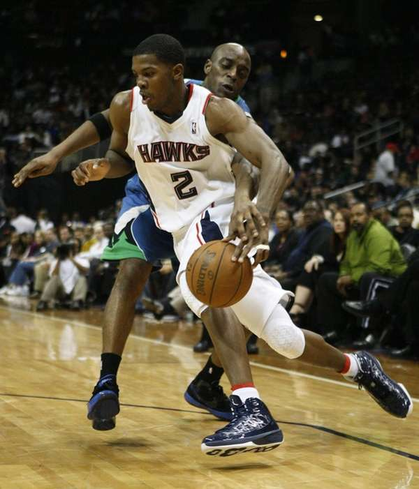 Atlanta's Joe Johnson drives past a Minnesota Timberwolves
