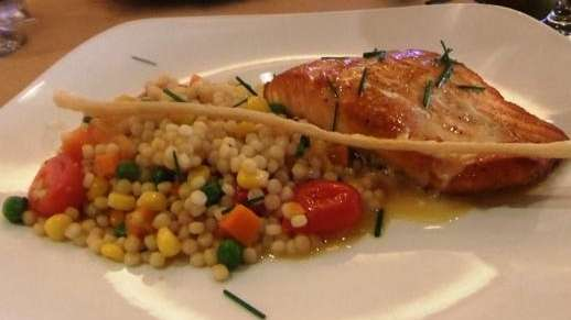 Pan-seared salmon with Israeli couscous at Sally's Cocofe,