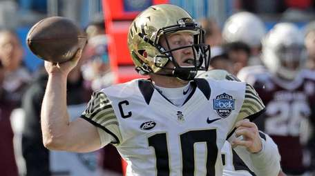Wake Forest's John Wolford (10) looks to pass