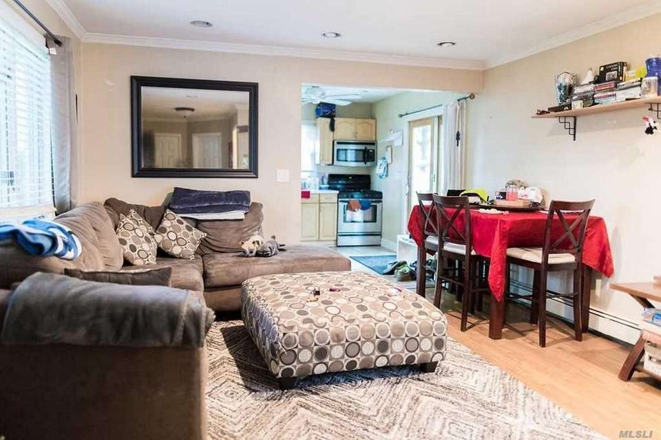 The living room flows into the eat-in kitchen,