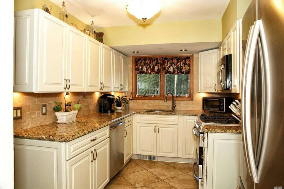 The main level includes an updated kitchen, a