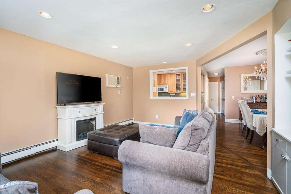 The open concept, with redone hardwood floors, includes