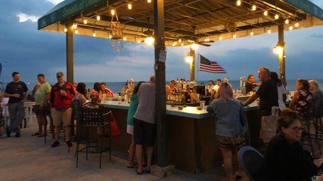 The evening scene at Sunsets at Cedar Beach,