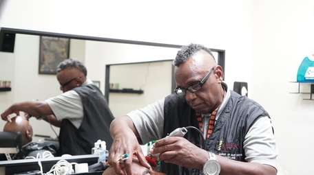Bobby Canady is barber for the single-chair barber