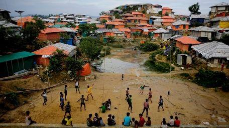 Rohingya refugees play at Balukhali Refugee Camp in