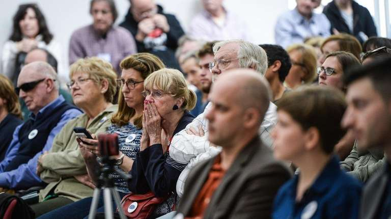 A crowd attends a forum on the Affordable