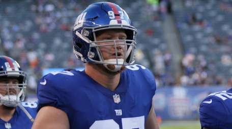 Giants defensive end Josh Mauro takes the field