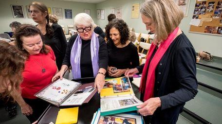 Members of Willow Interfaith Women's Choir thumb through