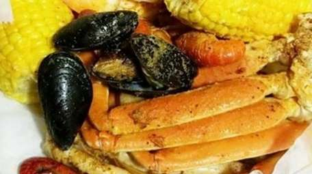 """The """"steam bowl"""" with shellfish, sausage, and corn"""