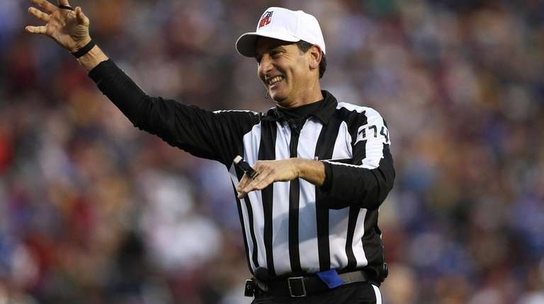 Referee Gene Steratore throws the ball during a