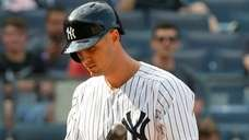 Yankees first baseman Greg Bird walks back to