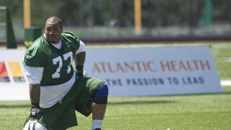 Jets defensive tackle Kris Jenkins takes a break