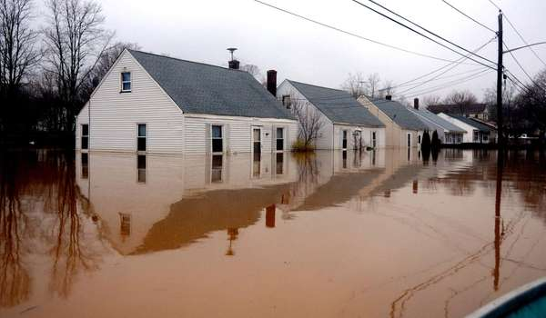 Homes are partially underwater along Horton Avenue in
