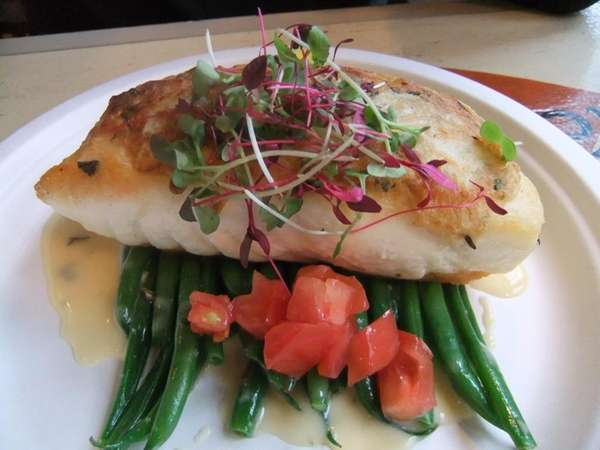 A potato-crusted halibut entree at Bostwick's Chowder House