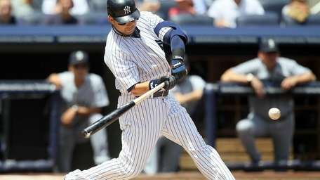 The Yankees' Nick Swisher connects on a first-inning