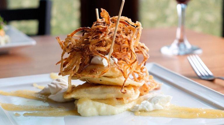 Grandma's pierogi comes topped with crispy fried onions,