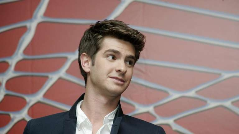 American actor Andrew Garfield poses for photographers during