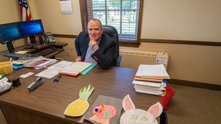 Islip Councilman James O'Connor displays artwork done by