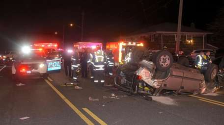 Emergency service vehicles respond to a five-car accident