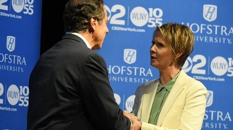 Gov. Andrew M. Cuomo and Cynthia Nixon arrive