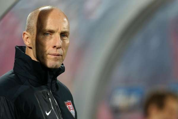 Bob Bradley looks on from the bench during