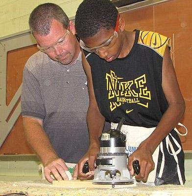 BOCES carpentry student and teacher