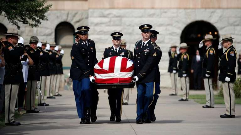 The Arizona National Guard carries the casket of
