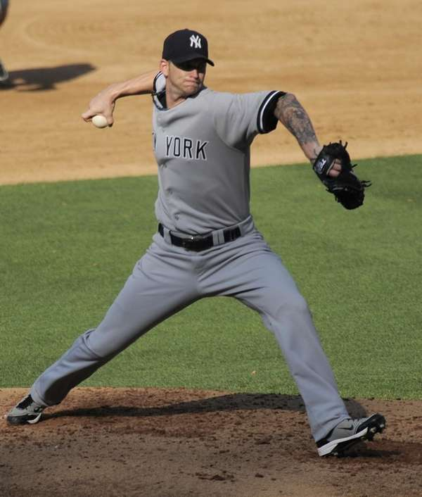 Yankees starting pitcher A.J. Burnett throws to the