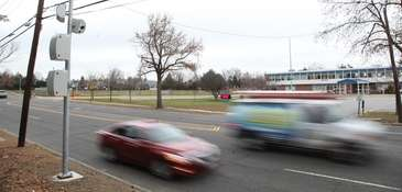 Cars pass speed cameras outside Cantiague Elementary School