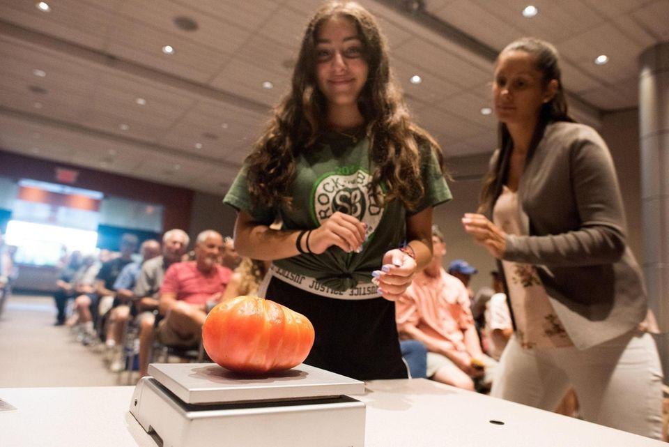 Nairi Vartanian, 13, of Garden City, weighs her