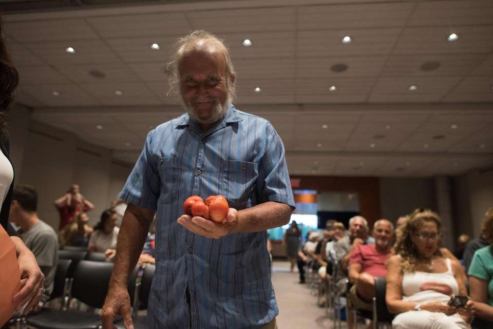 Joe Solarino of Melvillle with his tomatoes during