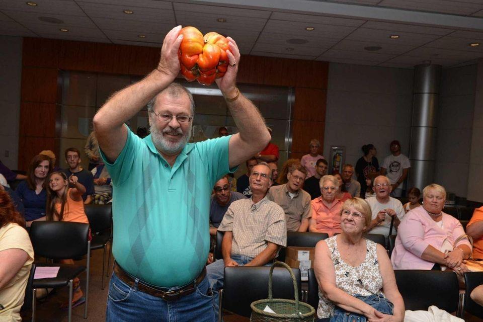 Gary Schaffer, 69, of Lindenhurst, holds up his