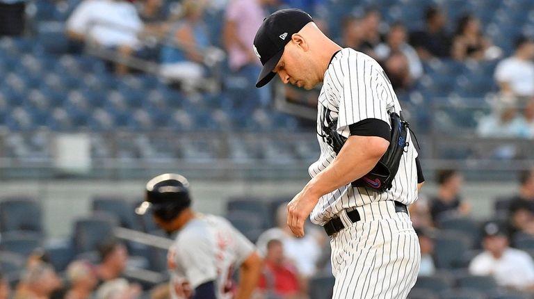 Yankees pitcher J.A. Happ kicks the dirt after