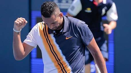 NIck Kyrgios reacts after winning a game against