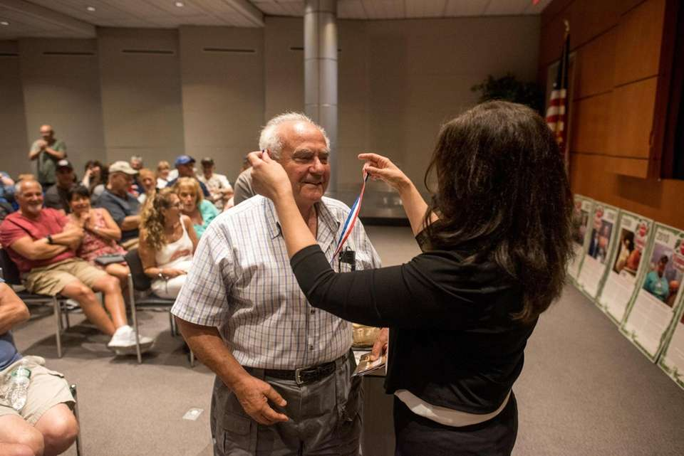 Anthony Maltese receives his award from Newsday's Jessica