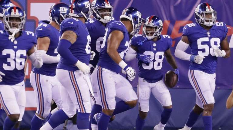 Giants cornerback Donte Deayon is surrounded by teammates