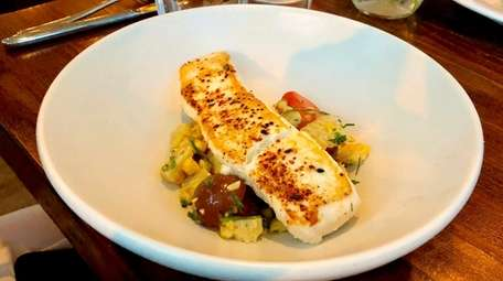 Halibut with roasted corn, tomatoes and chives is