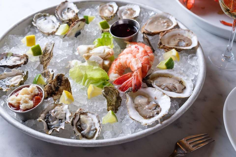 A combo of oysters, shrimp, and crab are