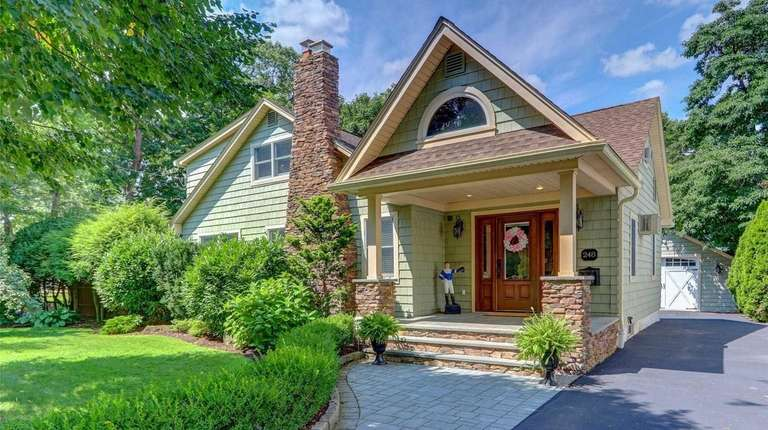 The Craftsman-style house, just a few furlongs from