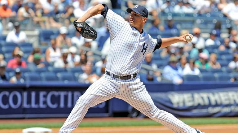 Yankees starting pitcher Andy Pettitte throws in the