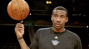 Phoenix Suns forward Amare Stoudemire spins a ball