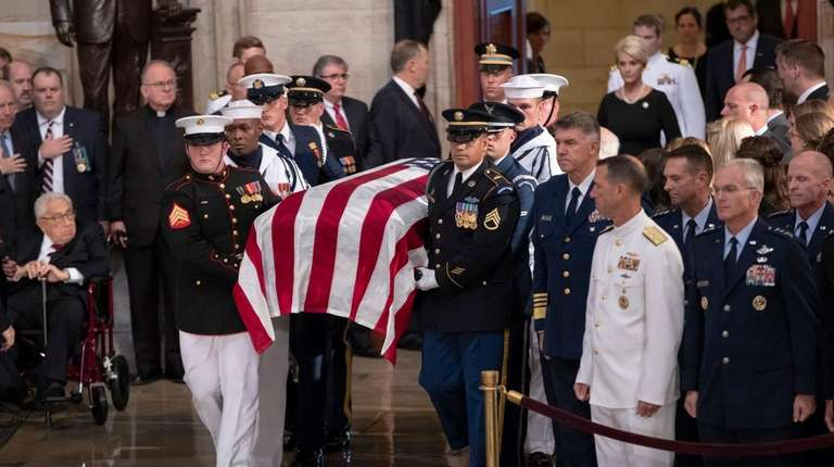 The flag-draped casket bearing the remains of Sen.