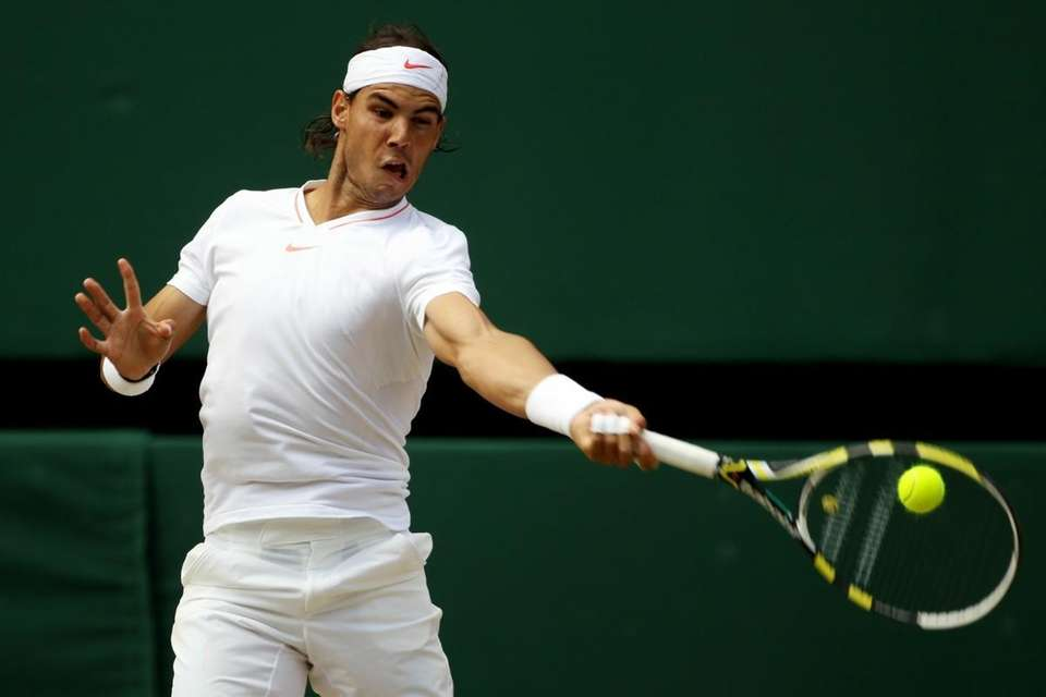 Rafael Nadal of Spain plays a shot during