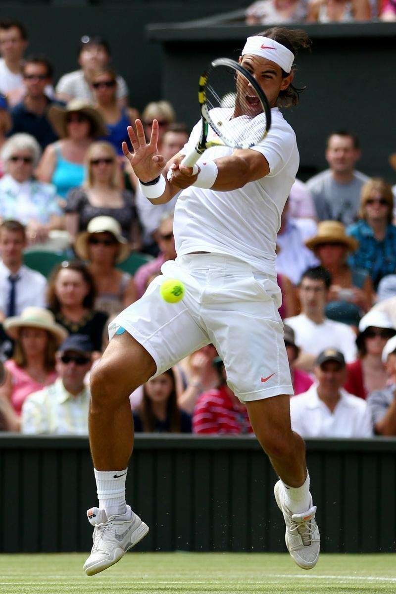 Rafael Nadal of Spain returns a shot during