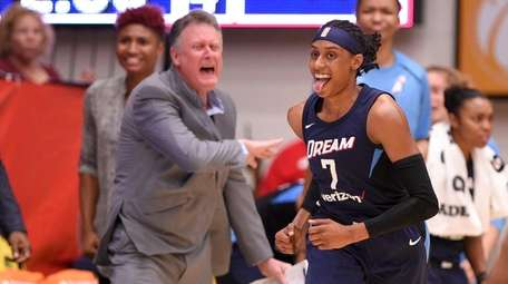 Dream guard Brittney Sykes reacts after she scored