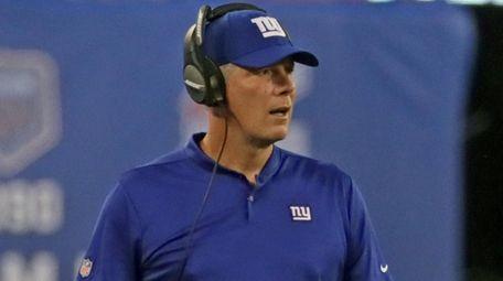 New York Giants head coach Pat Shurmur watches