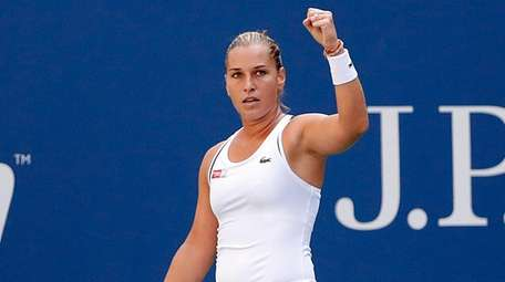 Dominika Cibulkova reacts after a winner against Angelique