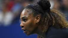Serena Williams looks for a serve from Venus