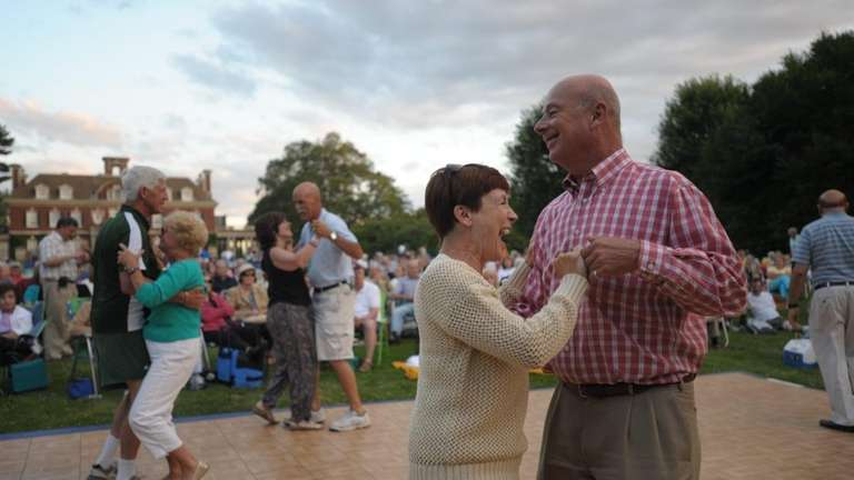 April Wenk (right) dances with her husband Norm