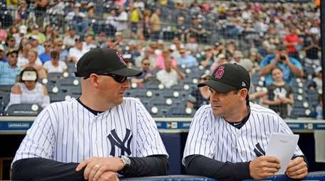 Josh Bard, usually the Yankees' bench coach, filled